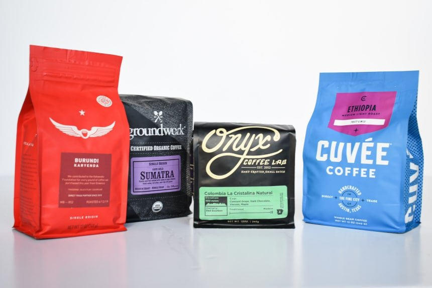 Mix of Trade Coffee Bags on White Background