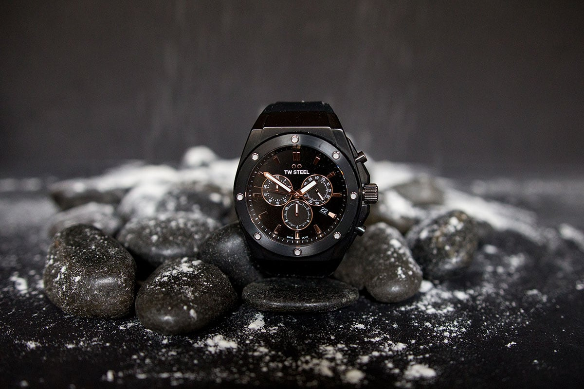 TW Steel CEO Tech watch propped up against black stones with snow on black background a 1