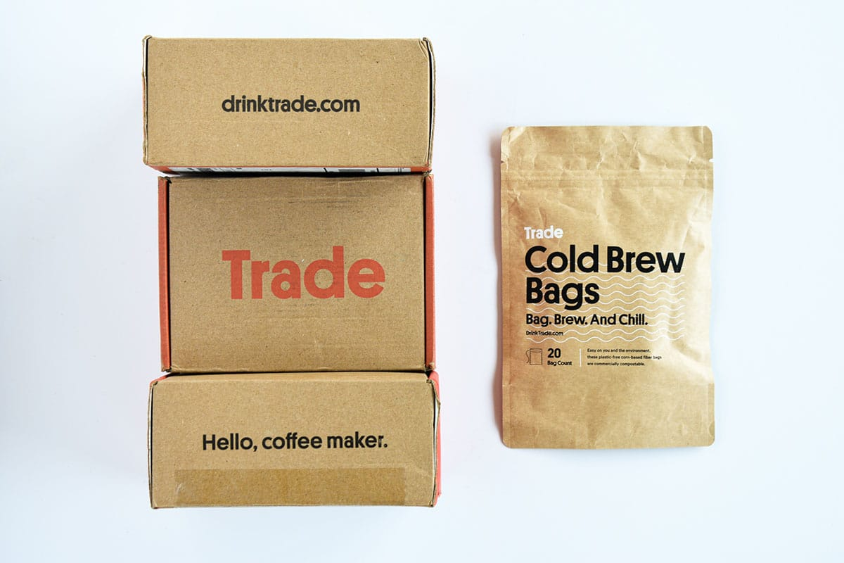 Trade Coffee Review Top Down of Box Packaging and Cold Brew Bags Bag