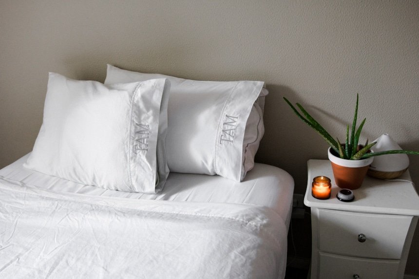 After shot of bed with Valentino 1200 Thread Count Cotton Sheets