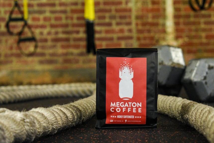 Megaton Coffee Bag Sitting on Gym Floor with Gym Gear in Background