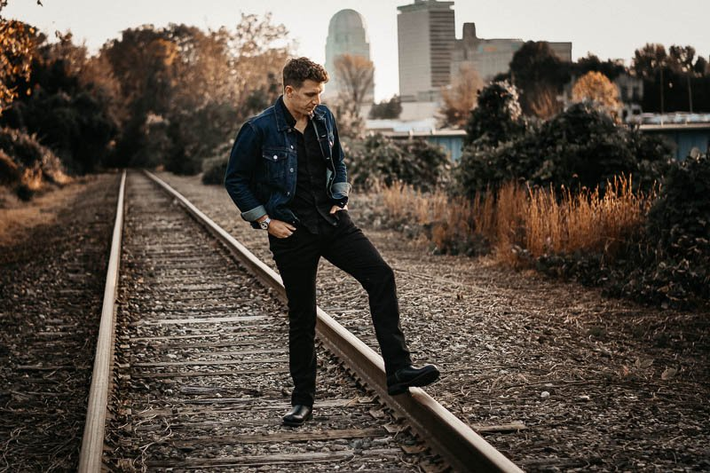 Mott and bow jay model standing on train tracks wearing MKE boot company