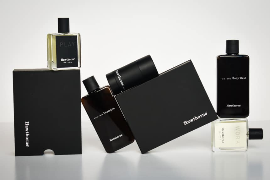 Hawthorne Cologne Review: Entire Set of Fragrance, Body Wash, Shampoo, And Deodorant, And Packaging Stacked in Jigsaw on White Background Straight On