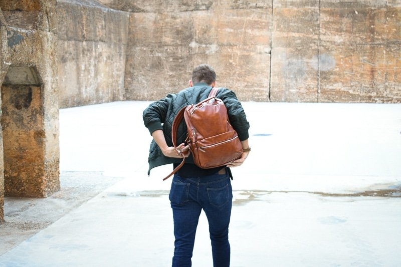 Modern made man leatherbackpack puton