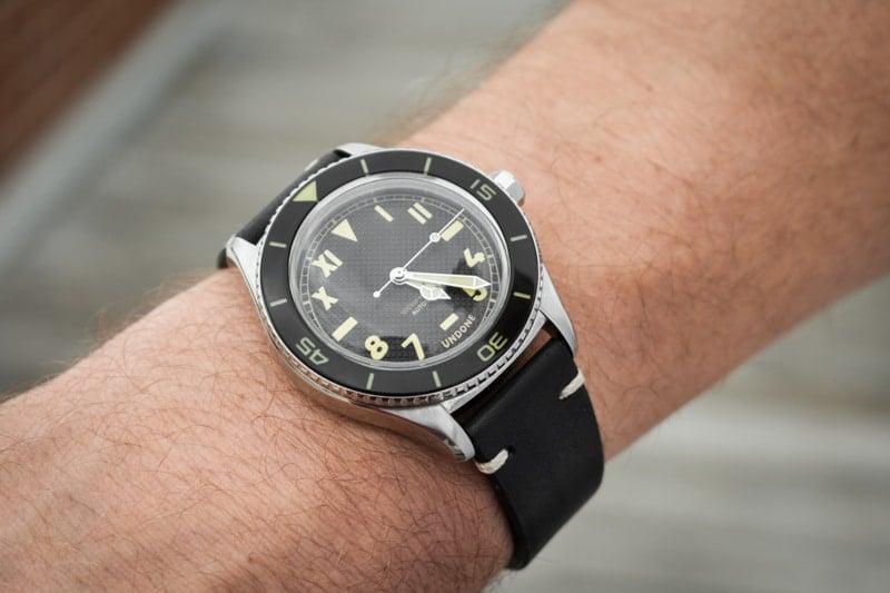 closeup wrist shot of model wearing watch