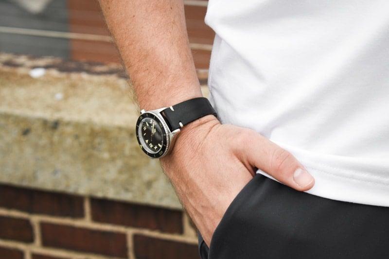 model wearing black watch