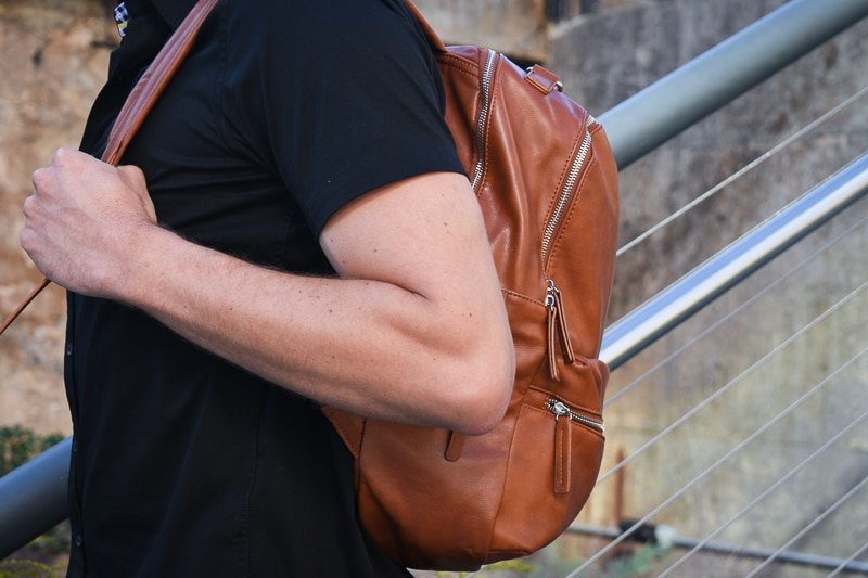 modern made man leather backpack closeup side 2