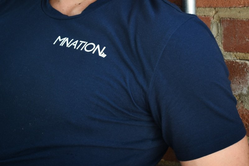 model wearing navy muscle nation shirt