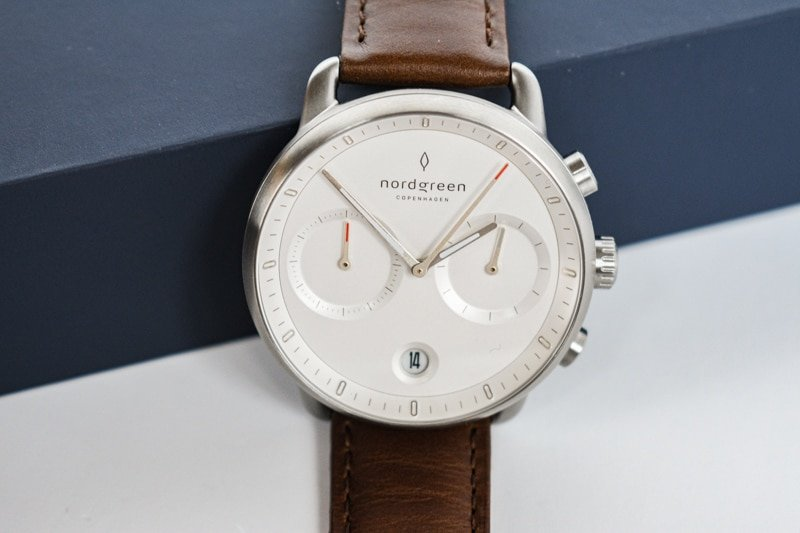 white dial nordgreen pioneer against blue packaging