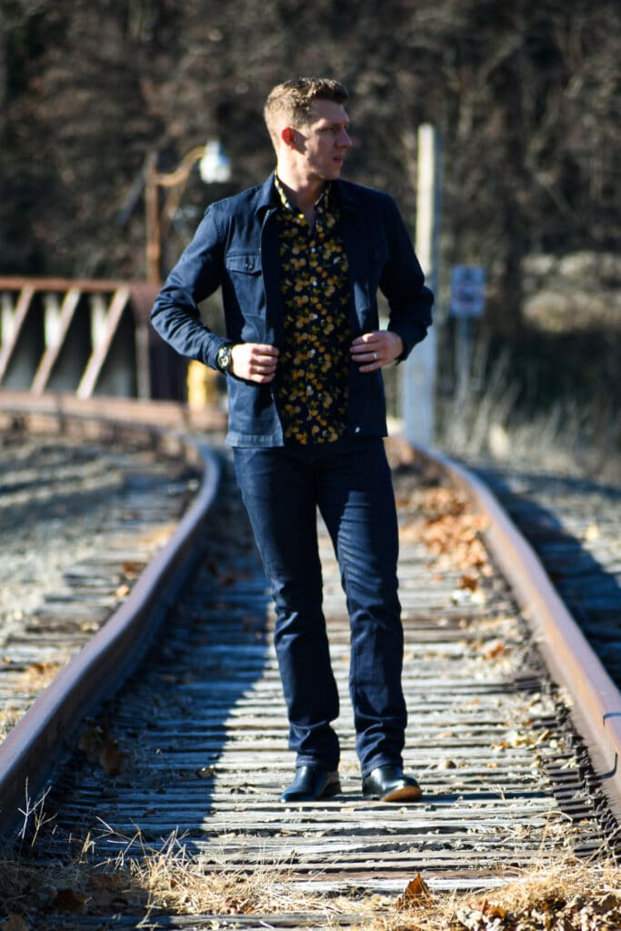 Mott and Bow model on train tracks dark blue jeans