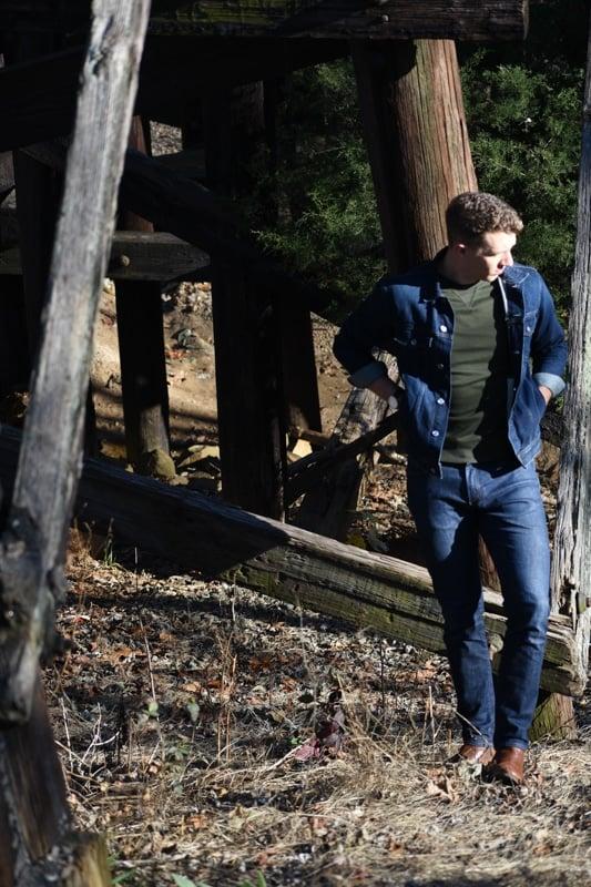 model wearing denim jacket denim pants and everlane terry sweater