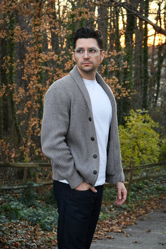 model wearing knit cardigan white tshirt and dark blue jeans