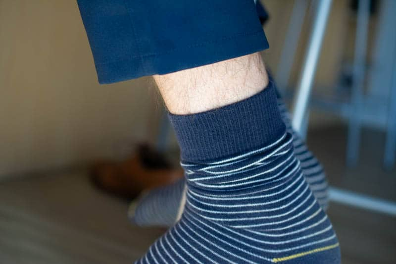ugly sock rolled down with leg showing