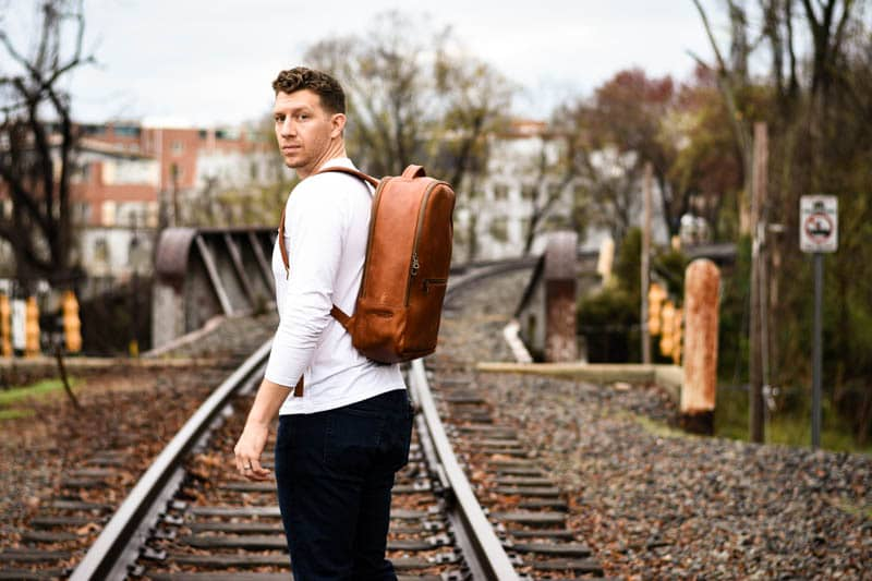 Model Looking back at camera with full grain leather backpack