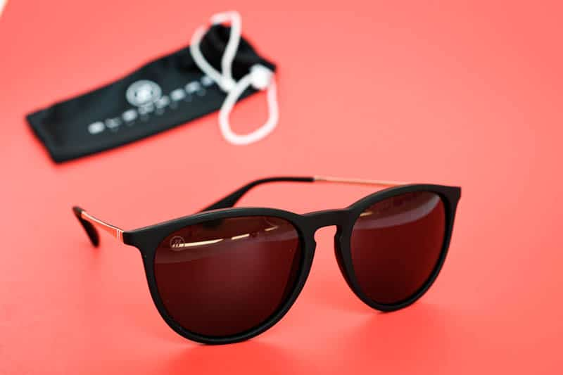 Blenders Eyewear university heights on red background sunglasses