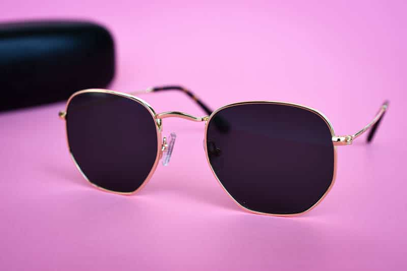 Blenders Eyewear whiskey shiner hexagram sunglasses on pink background