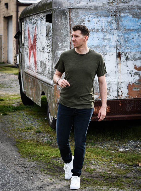 model walking toward camera with green rag and bone tshirt and white sneakers