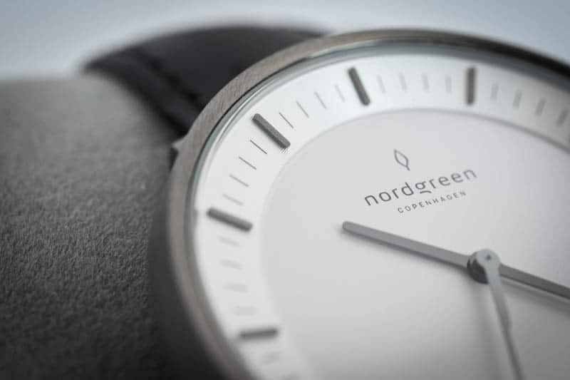 side view nordgreen philosopher logo on white dial indices closeup