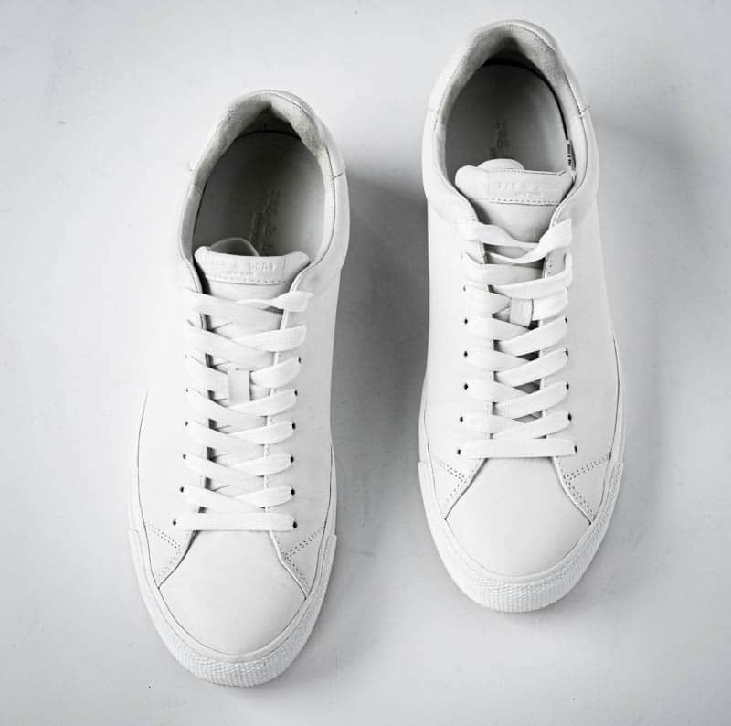 top down product image of rag and bone rb1 low white minimalist sneakers on white background