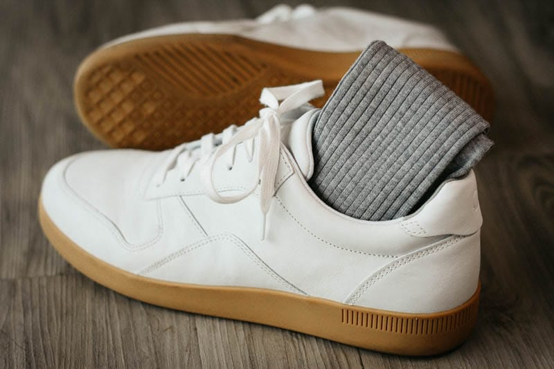 asket grey ribbed cotton socks tucked into white everlane tread sneakers