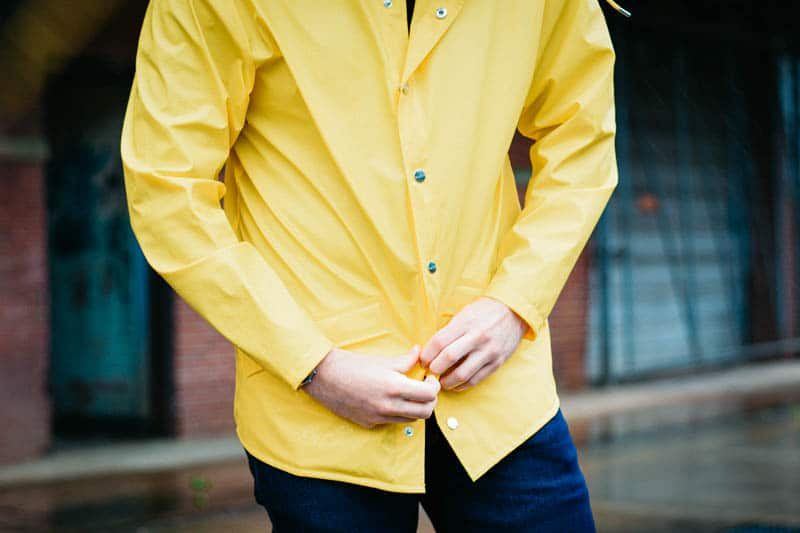 closeup of yellow rain jacket from rains