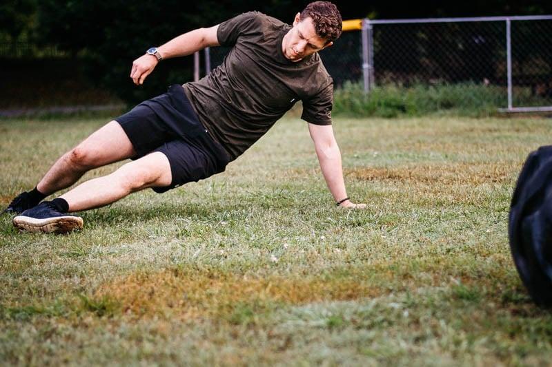 model exercising on grass field wearing vuori workout apparel