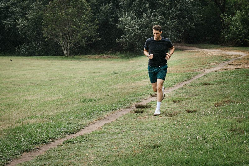 model running in the distance with vuori workout shorts