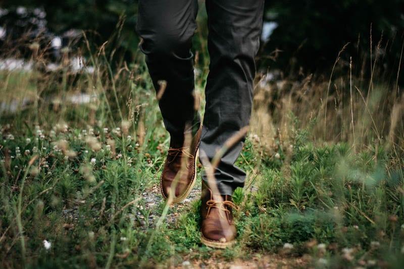 model walking toward camera wearing clarks desert boot
