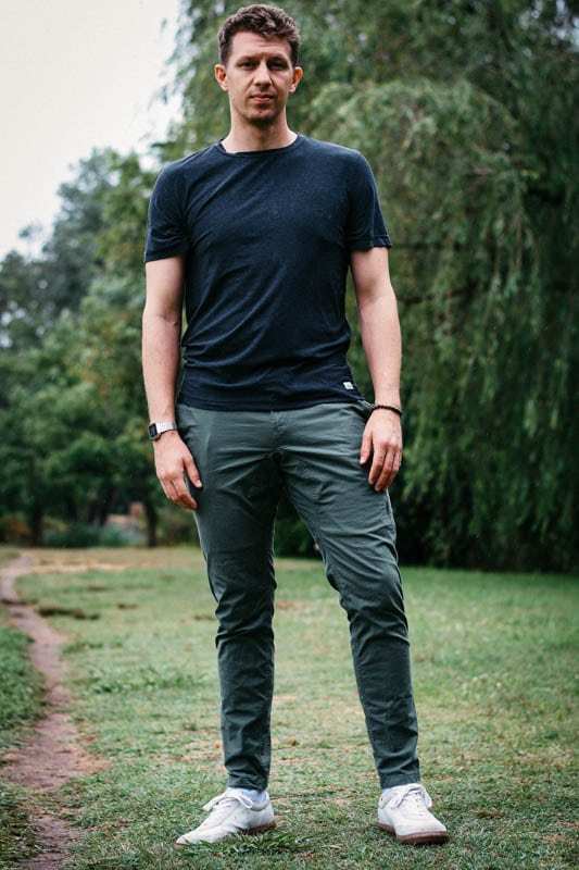 model wearing vuori ripstop climbing pants and tradwind shirt