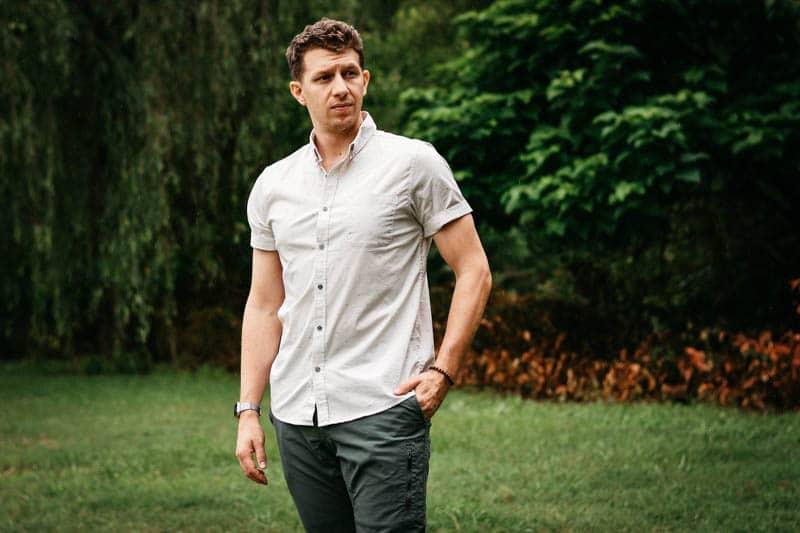 model wearing vuori short sleeve crest shirt and climbing ripstop pants
