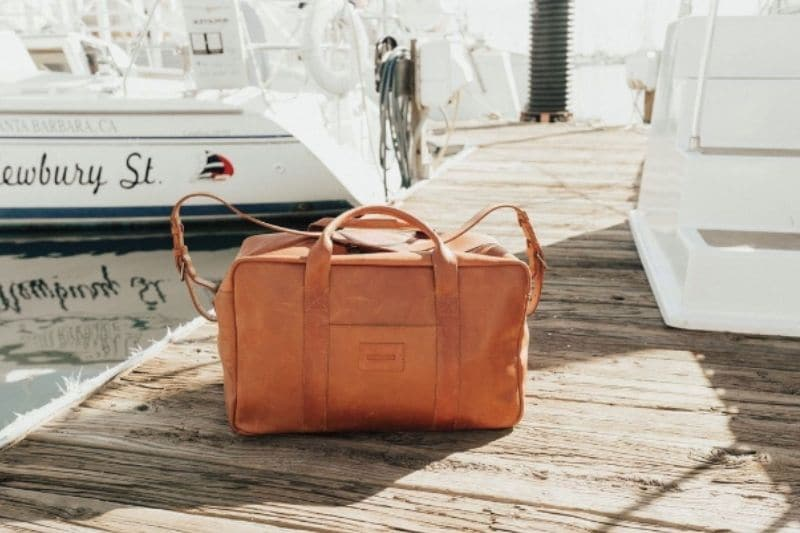 Parker Clay Montecito Weekender bag leather on boating dock