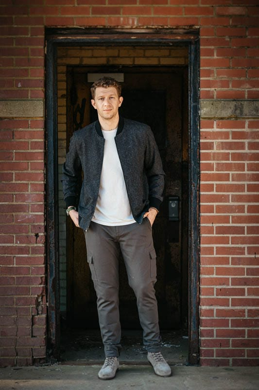 model standing in brick doorway wearing paige jacket and suede boots