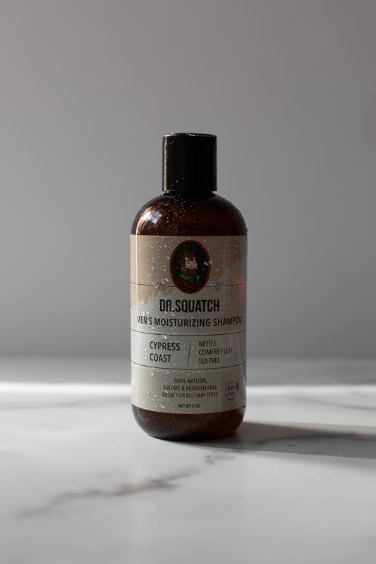Dr. Squatch Cedar Cypress shampoo with water detail