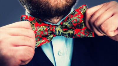 Gamma Male Man with Unkempt Beard Wearing Colorful Red Bowtie