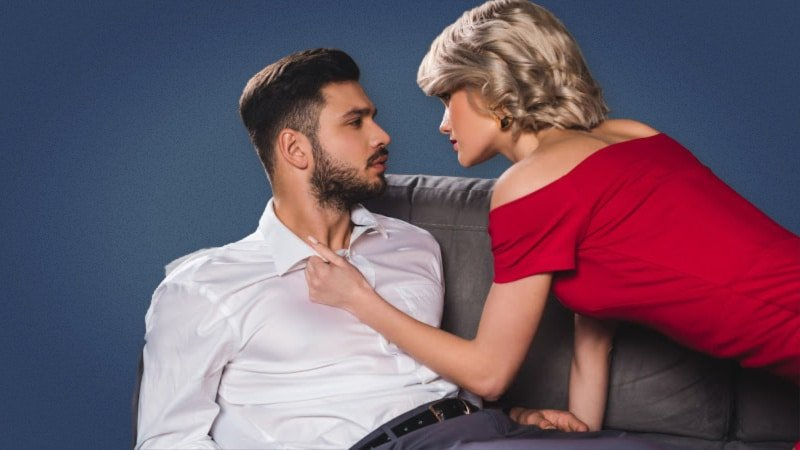 Graphic of an attractive woman in a red dress seeking out a man on a couch 1