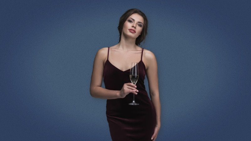 Stylish woman holding champagne in evening dress 1