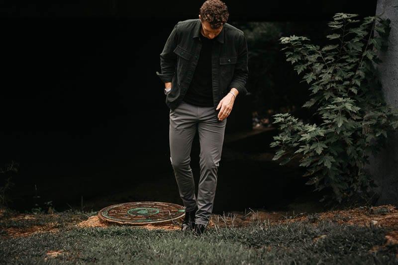 model in rhone commuter pants grey slim