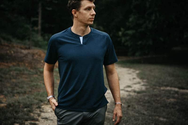 model wearing blue rhone notch perfomance shirt rhone review apparel 1