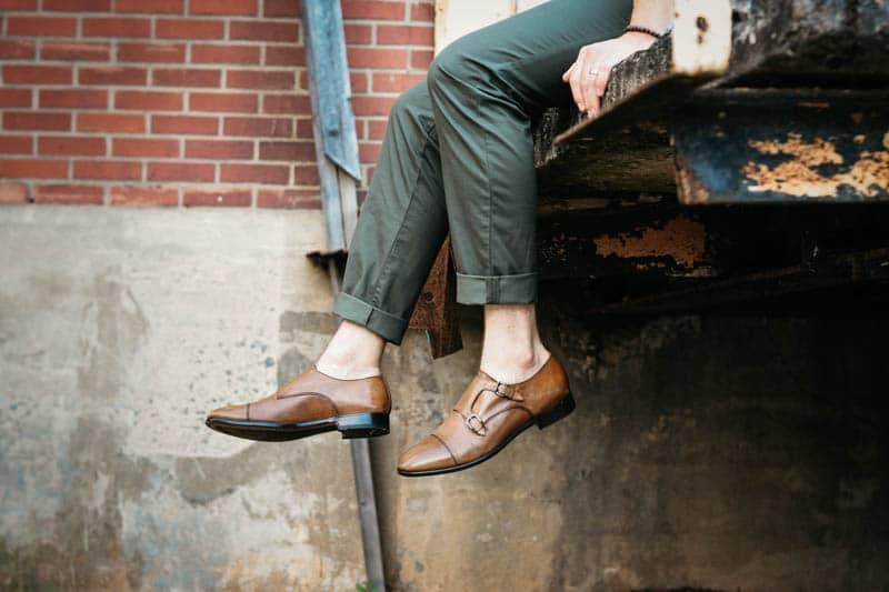 model wearing mgemi tommasso double monk strap shoes feet dangling