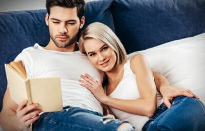 Best Dating Books for Men  Attractive guy reading a book with an attractive woman