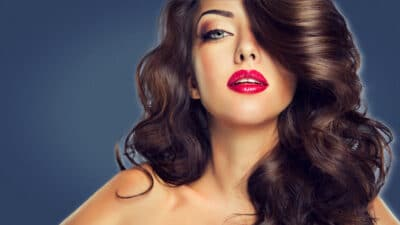 High Maintenance Girl Attractive Brunette Woman in Red Lipstick Makeup and Professional Hairstyle