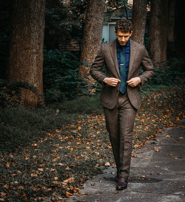 JCrew Ludlow suit brown vertical model walking with blue shirt