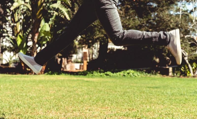 Man jumping mid air in Soludos