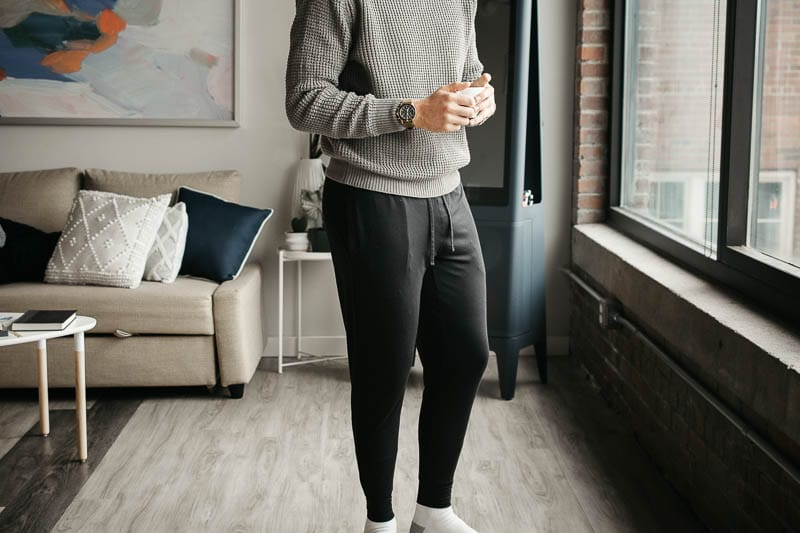model holding coffee wearing Tommy John relaxed comfort joggers 1