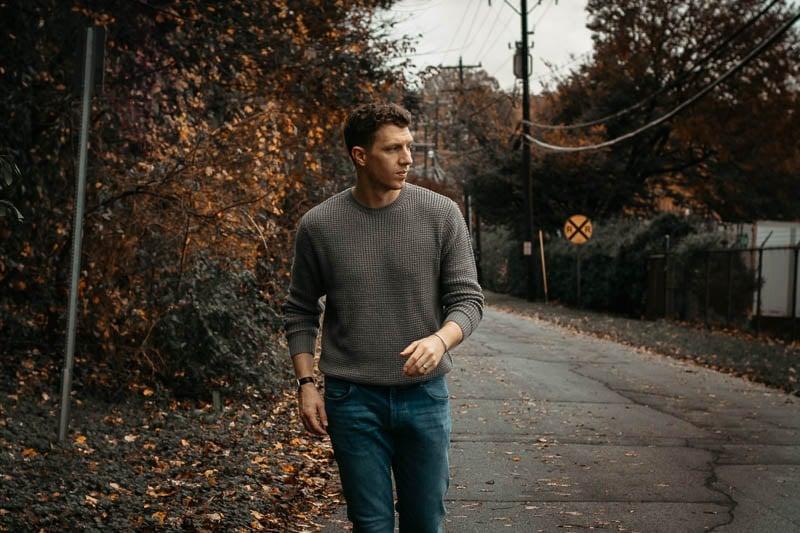 model walking down street wearing grey knit sweater from liverpool los angeles