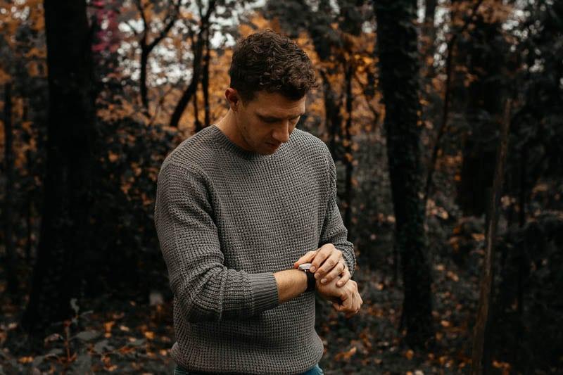 model wearing minimalist nordgreen watch wearing Liverpool Jeans los angeles knit sweater grey