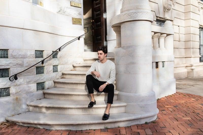 Breland Kiltie Tassel loafer sitting on steps
