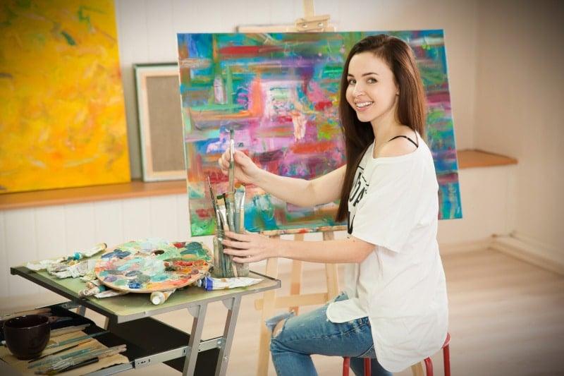 Attractive Woman Painting in Art Studio