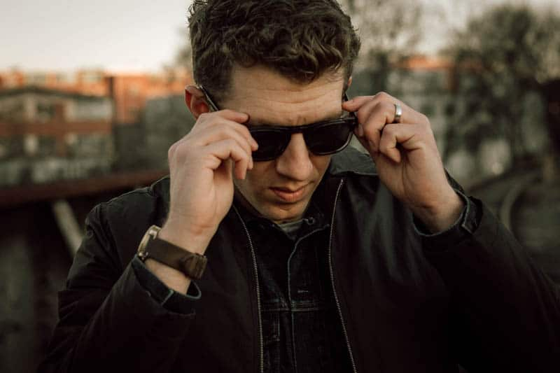Christopher Cloos model putting on cloos x brady sunglasses