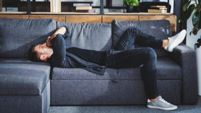 Why Is Life So Hard Stylish Man Having a Bad Day Lying on Sofa